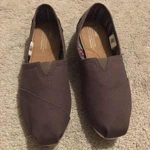 Brand new, never worn TOMS classic, size 7.5
